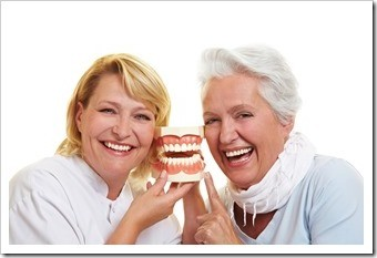 Removable partial dentures usually involve replacement teeth attached to plastic bases, connected by metal framework.